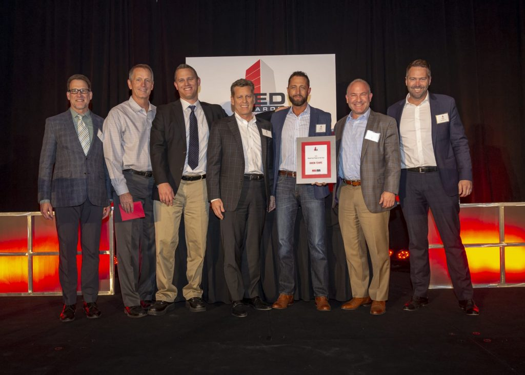 (From left to right) Rich Gohl, Jim Drago, Kelly Wyllie, Larry Pobuda (Opus), Garren Echols, Brett Hopper (Opus) and Ryan Abbott accept the award for Mixed-Use Project of the Year for Union Tempe