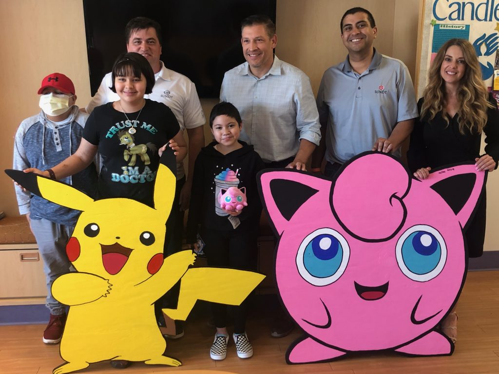 El Paso Children's Hospital oncology patients pose with Pikachu, Jigglypuff and the Sundt team