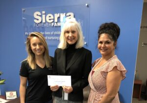 sierra forever families receives check from the sundt foundation