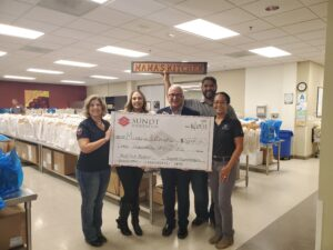 sundt foundation presents a check to mamas kitchen