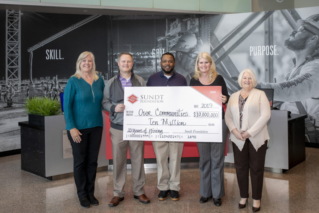 Sundt Foundation members pose with a commemorative check for $10 million