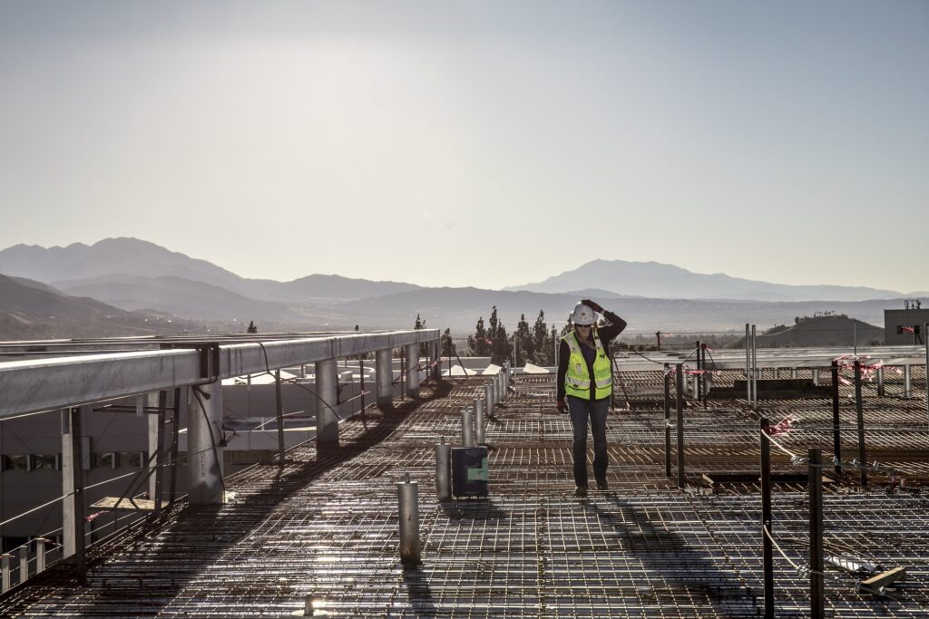 Reese performing a roof inspection on the Center for Global Innovation project at CSU San Bernadino during a windy day