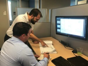 Sundt Industrial Preconstruction Manager Steve Bradford helps a colleague with estimating