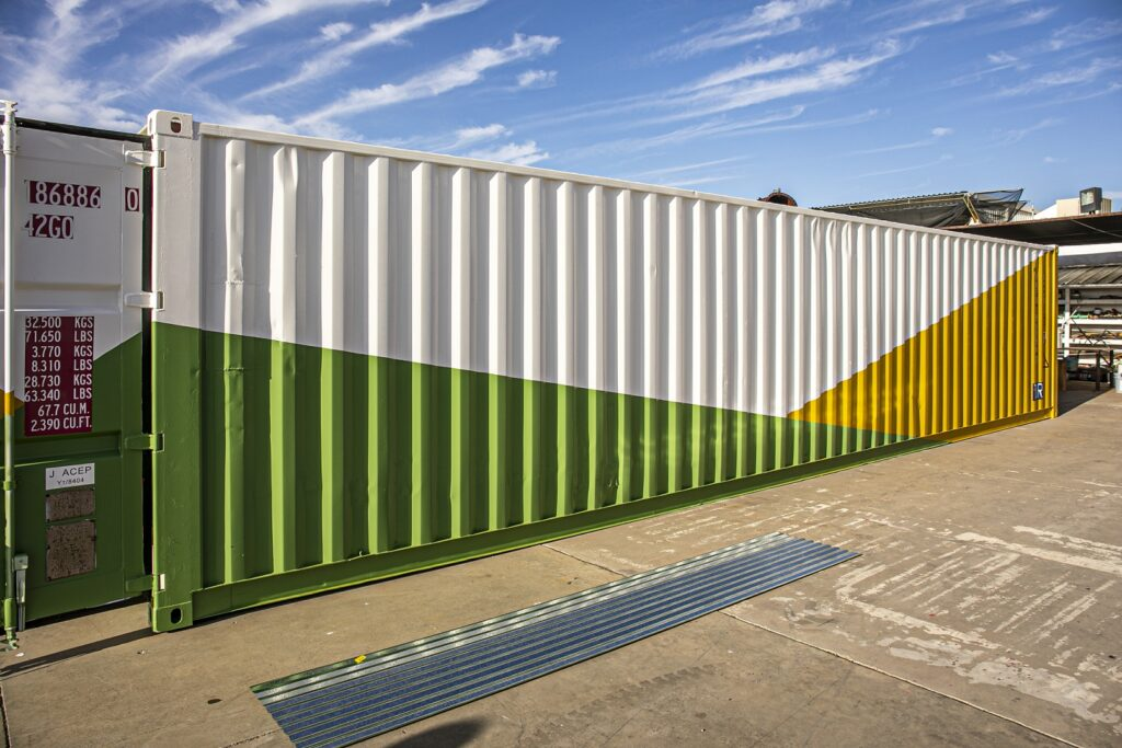 exterior of shipping container painted green and yellow for sustainability