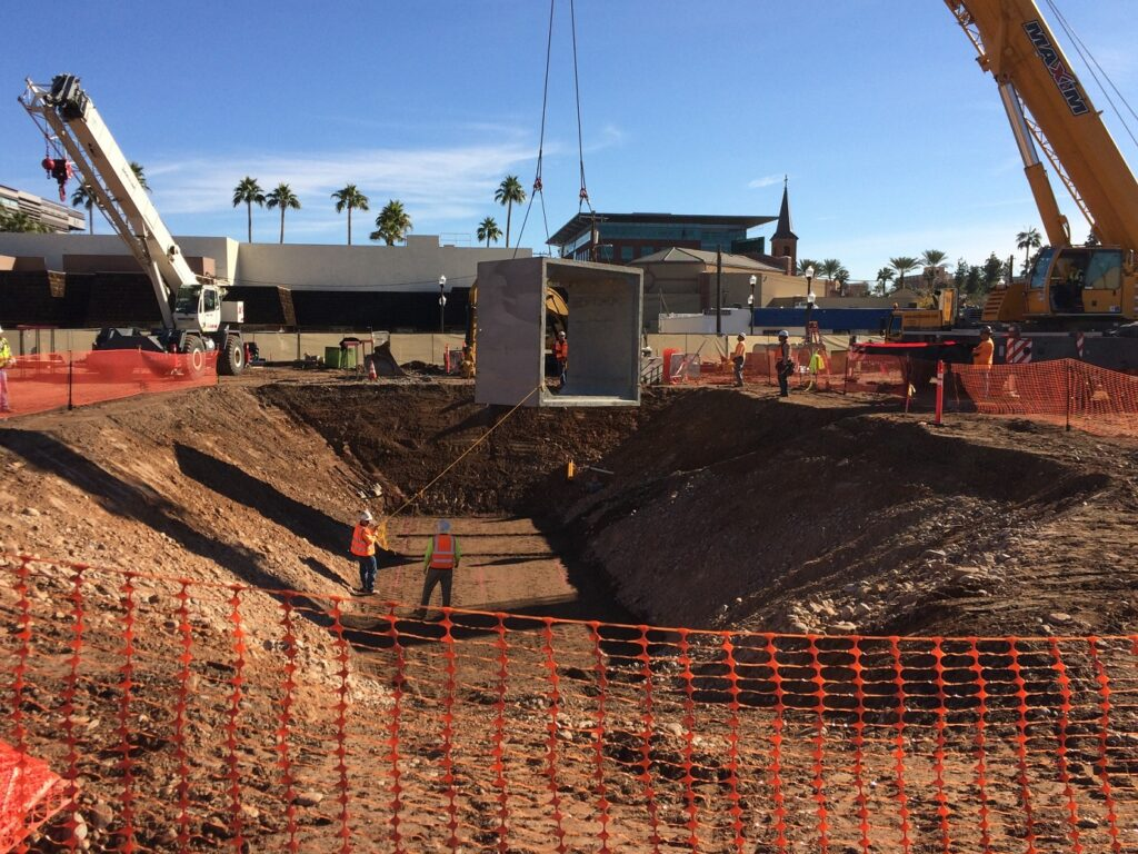 Sundt crew members place a 10- by 10-foot box culvert at the Union Tempe residential and retail mixed-use development project
