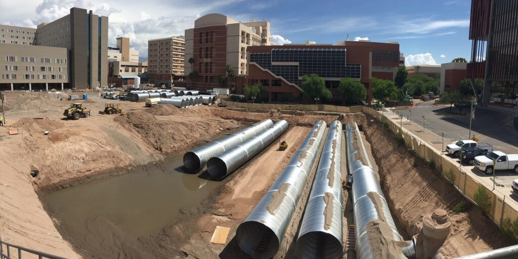 placement of 10 foot underground pipes for Banner UMC hospital construction project in Tucson