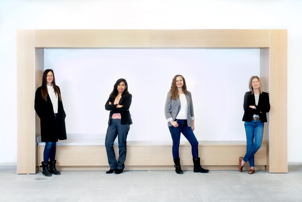 four women pose for professional group photo