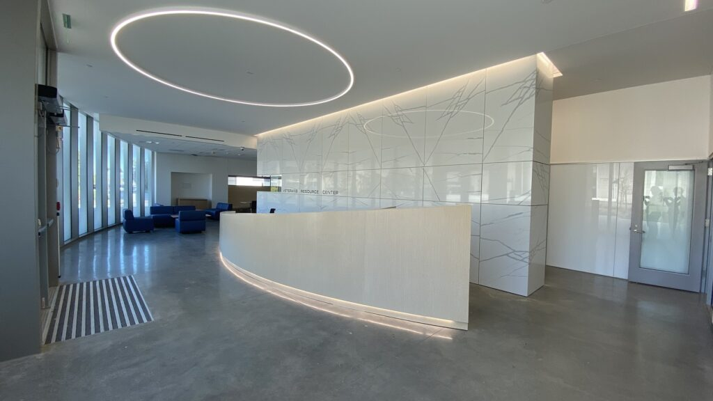lobby with white marble walls at new veterans resource center at Cypress College